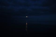 Mondaufgang über dem Meer vor Juist